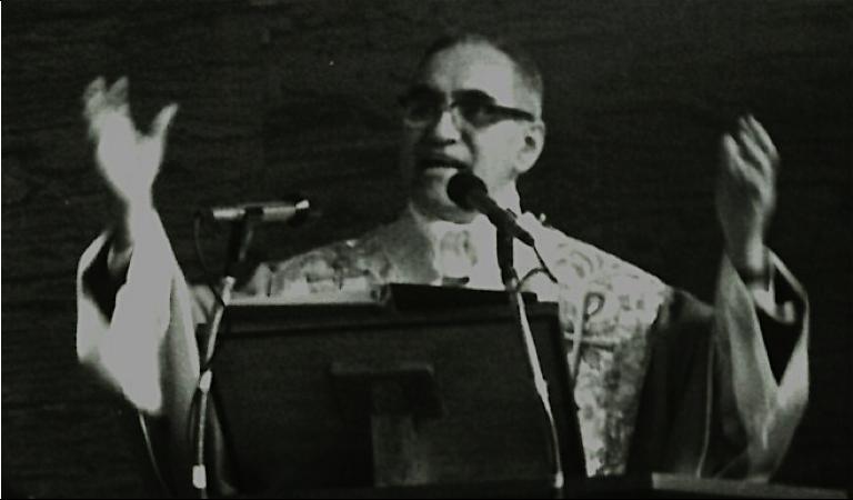 ART Romero preaching.png
